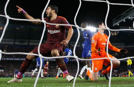 Barcelona's Luis Suarez reacts during a Champions League round of sixteen first leg soccer match between FC Barcelona and Chelsea at Stamford Bridge stadium in London, Tuesday, Feb. 20, 2018. (AP Photo/Alastair Grant)