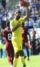 Liverpool goalie Alisson Becker applauds fans after the English Premier League soccer match between Leicester City and Liverpool at the King Power Stadium in Leicester, England, Saturday, Sept. 1, 2018. (AP Photo/Rui Vieira)