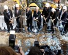 Forest City Ratner CEO Bruce Ratner, left, Mayor Michael Bloomberg, second from left, Governor David Paterson, third from left, Brooklyn Borough President Marty Markowitz, fourth from right, entertainer Jay-Z, third from right, Delia Hunley-Adossa, second from right, and President of Barclays Robert Diamond shovel dirt during the ground breaking for the Barclays Center in the Brooklyn borough of New York, Thursday, March 11, 2010.  (AP Photo/Seth Wenig)