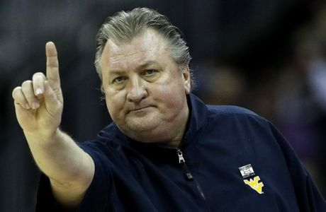 West Virginia head coach Bob Huggins motions to his players during the first half of the NCAA college basketball championship game against Kansas in the Big 12 men's tournament Saturday, March 10, 2018, in Kansas City, Mo. (AP Photo/Charlie Riedel)