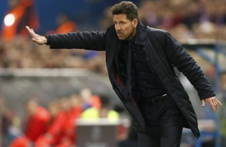 Atletico's head coach Diego Simeone gestures during the Champions League round of 16 second leg soccer match between Atletico Madrid and Bayer Leverkusen at the Vicente Calderon stadium in Madrid, Spain, Wednesday, March 15, 2017. (AP Photo/Daniel Ochoa de Olza)