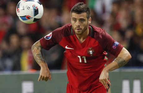 Portugal's Vieirinha throws the ball in, during the Euro 2016 Group F soccer match between Portugal and Austria at the Parc des Princes stadium in Paris, France, Saturday, June 18, 2016. (AP Photo/Christophe Ena)