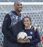 Women Soccer player and FIFA Women's Player of the Year Marta Vieira da Silva, right, poses with Los Angeles Lakers basketball player Kobe Bryant pose for photographers at a press conference in Carson, California on Thursday, March 5, 2009. Marta will play for the Los Angeles Sol in the new Women's Professional Soccer league. (AP Photo/Hector Mata)