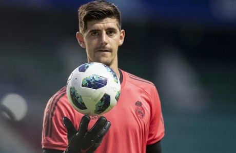 Real Madrid's Thibaut Courtois attends a training session at the Lillekula Stadium, a day ahead of UEFA Super Cup final soccer match between Real Madrid and Atletico Madrid in Tallinn, Estonia, Tuesday, Aug. 14, 2018. (AP Photo/Pavel Golovkin)