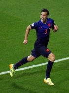 SALVADOR, BRAZIL - JUNE 13:  Robin van Persie of the Netherlands celebrates after scoring his second goal and his team's fourth during the 2014 FIFA World Cup Brazil Group B match between Spain and Netherlands at Arena Fonte Nova on June 13, 2014 in Salvador, Brazil.  (Photo by Jeff Gross/Getty Images)