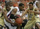 Georgia Tech forwards Gani Lawal, left, and Alade Aminu (44) double team Clemson guard K.C. Rivers during the second half of an NCAA college basketball game at the Atlantic Coast Conference men's tournament in Atlanta, Thursday, March 12, 2009.   (AP Photo/Dave Martin)