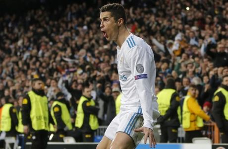 Real Madrid's Cristiano Ronaldo reacts after scoring his side's second goal during a Round of 16, 1st leg Champions League soccer match between Real Madrid and Paris Saint Germain at the Santiago Bernabeu stadium in Madrid, Spain, Wednesday Feb. 14, 2018.(AP Photo/Paul White)