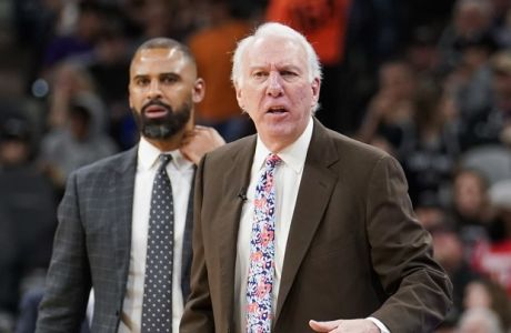 San Antonio Spurs head coach Gregg Popovich, right, yells at referee Mark Ayotte, left, during the first half of an NBA basketball game against the Houston Rockets, Friday, Nov. 30, 2018, in San Antonio. (AP Photo/Darren Abate)