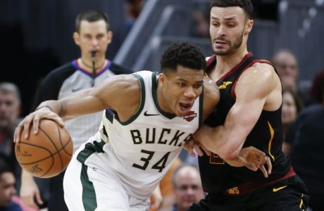 Milwaukee Bucks' Giannis Antetokounmpo (34), from Greece, drives on Cleveland Cavaliers' Larry Nance Jr. (22) during the second half of an NBA basketball game Friday, Dec. 14, 2018, in Cleveland. The Bucks defeated the Cavaliers 114-102. (AP Photo/Ron Schwane)
