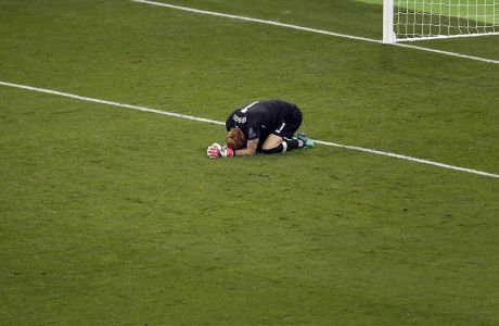 Liverpool goalkeeper Loris Karius reacts after the Champions League Final soccer match between Real Madrid and Liverpool at the Olimpiyskiy Stadium in Kiev, Ukraine, Saturday, May 26, 2018. (AP Photo/Darko Vojinovic)