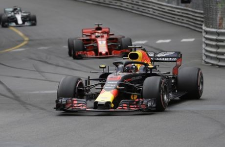 Red Bull driver Daniel Ricciardo of Australia leads at the start and followed by Ferrari driver Sebastian Vettel of Germany and Mercedes driver Lewis Hamilton of Britain during the Formula One race, at the Monaco racetrack, in Monaco, Sunday, May 27, 2018. (AP Photo/Luca Bruno)