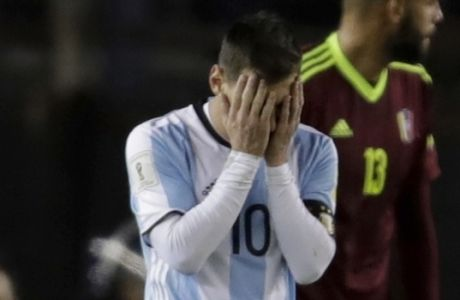 Argentina's Lionel Messi reacts during a 2018 World Cup qualifying soccer match against Venezuela in Buenos Aires, Argentina, Tuesday, Sept. 5, 2017 (AP Photo/Victor R. Caivano)
