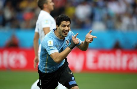 SAO PAULO, BRAZIL - JUNE 19: Luis Suarez of Uruguay celebrates scoring his team's first goal during the 2014 FIFA World Cup Brazil Group D match between Uruguay and England at Arena de Sao Paulo on June 19, 2014 in Sao Paulo, Brazil.  (Photo by Richard Heathcote/Getty Images)