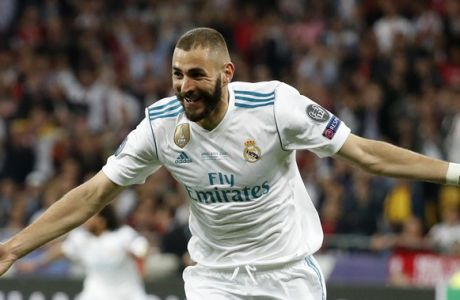 Real Madrid's Karim Benzema celebrates after scoring the opening goal during the Champions League Final soccer match between Real Madrid and Liverpool at the Olimpiyskiy Stadium in Kiev, Ukraine, Saturday, May 26, 2018. (AP Photo/Pavel Golovkin)