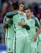 Portugal's Cristiano Ronaldo hugs teammate Bruno Alves as he celebrates his side's 1-0 win at the end of the Confederations Cup, Group A soccer match between Russia and Portugal, at the Spartak Stadium in Moscow, Wednesday, June 21, 2017. (AP Photo/Ivan Sekretarev)