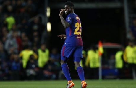 Barcelona's Samuel Umtiti celebrates the second goal of his team against Roma during a Champions League quarter-final, first leg soccer match between FC Barcelona and Roma at the Camp Nou stadium in Barcelona, Spain, Wednesday, April 4, 2018.(AP Photo/ Manu Fernandez)