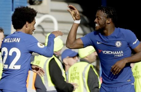 Chelsea's Michy Batshuayi, right, celebrates scoring his side's fourth goal with Chelsea's Willian during the English Premier League soccer match between Chelsea and Watford at Stamford Bridge stadium in London, Saturday, Oct. 21, 2017. (AP Photo/Matt Dunham)