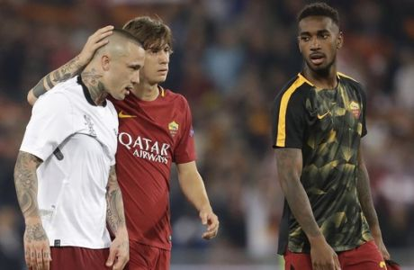 Roma's Radja Nainggolan, left, is consoled by Roma's Mirko Antonucci after the Champions League semifinal second leg soccer match between Roma and Liverpool at the Olympic Stadium in Rome, Wednesday, May 2, 2018. Liverpool win 7-6 on aggregate.(AP Photo/Andrew Medichini)
