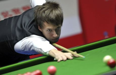 In this photo provided by China's Xinhua News Agency,  Judd Trump of England competes during the quarterfinal against Stephen Lee of England at the 2012 Snooker China Open in Beijing, China, Friday, March 30, 2012. (AP Photo/Xinhua, Gong Lei)  NO SALES