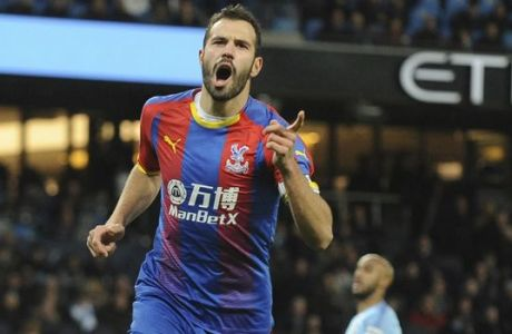 Crystal Palace's Luka Milivojevic celebrates with his teammates after scoring his side's third goal during the English Premier League soccer match between Manchester City and Crystal Palace at Etihad stadium in Manchester, England, Saturday, Dec. 22, 2018. (AP Photo/Rui Vieira)