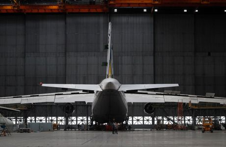epa07573531 Journalists and visitors look the Ukrainian Antonov An-124-100 'Ruslan' aircraft in the assembly shop of the Antonov aircraft plant in Kiev in Kiev, Ukraine, 15 May 2019. State-owned Antonov is a manufacturer of freight and passenger aircraft, as well as special purpose aircraft. Among the company`s most recognized projects are the An-32, An-148, An-158, An-74, An-124, An-70, and An-225. Currently, there are ten aircraft of the An-148 and An-158 families at shops, at varying stages as President of Ukrainian-based State Enterprise Antonov Oleksandr Donets told local media on 26 April 2019.  EPA/SERGEY DOLZHENKO