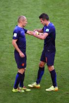 PORTO ALEGRE, BRAZIL - JUNE 18:  Robin van Persie of the Netherlands hands over the captain armband to Arjen Robben during the 2014 FIFA World Cup Brazil Group B match between Australia and Netherlands at Estadio Beira-Rio on June 18, 2014 in Porto Alegre, Brazil.  (Photo by Paul Gilham/Getty Images)