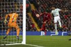 Liverpool's Mohamed Salah, center, fails to score a header past Bayern goalkeeper Manuel Neuer, left, and Bayern defender David Alaba during the Champions League round of 16 first leg soccer match between Liverpool and Bayern Munich at Anfield stadium in Liverpool, England, Tuesday, Feb. 19, 2019. (AP Photo/Dave Thompson)
