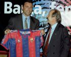 Bulgaria's Hristo Stoichkov, left, smiles as he holds up a F.C. Barcelona shirt accompanied by F.C. Barcelona's president Josep Lluis Nunez after he signed for the Catalan powerhouse for the next two seasons. Stoichkov played for Barcelona from 1990 to 1995 joining Italian club Parma in the 95-96 season. (AP Photo/Cesar Rangel)