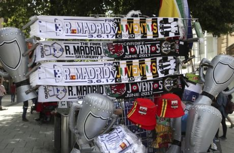 Merchandise on sale in Cardiff Wales  Thursday June 1, 2017 ahead of the Women's Champions League Final Thursday evening between Lyon and PSG and the men's final on Saturday between Juventus and Real Madrid. (Nick Potts/PA via AP)