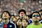 TOKYO, JAPAN - JUNE 15:  Japanese fans react after Japan is defeated during the 2014 FIFA World Cup match between Japan and Cote d'Ivoire during the public viewing event at Tokyo Dome on June 15, 2014 in Tokyo, Japan.  (Photo by Keith Tsuji/Getty Images)