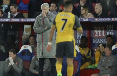 Arsenal manager Arsene Wenger looks across the pitch during the English Premier League soccer match between Crystal Palace and Arsenal at Selhurst Park in London, Monday April 10, 2017. (AP Photo/Tim Ireland)
