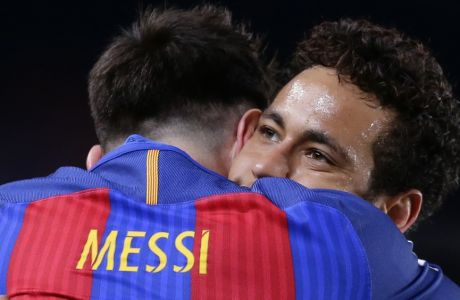 FC Barcelona's Lionel Messi, left, is embraced by team mate Neymar as they celebrate after scoring a goal during the Spanish La Liga soccer match between FC Barcelona and Valencia at the Camp Nou stadium in Barcelona, Spain, Sunday, March 19, 2017. (AP Photo/Manu Fernandez)