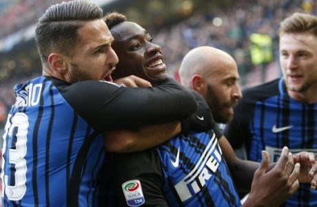 Inter Milan's Yann Karamoh, second from left, celebrates with his teammates after scoring his side's second goal during the Serie A soccer match between Inter Milan and Bologna at the San Siro stadium in Milan, Italy, Sunday, Feb. 11, 2018. (AP Photo/Antonio Calanni)