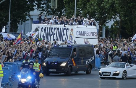 Real Madrid arrive on an open-topped bus to Cibeles square to celebrate after winning the Champions League final, Madrid, Spain, Sunday June 4, 2017. Real Madrid became the first team in the Champions League era to win back-to-back titles with their 4-1 victory over Juventus in Cardiff Saturday. (AP Photo/Paul White)