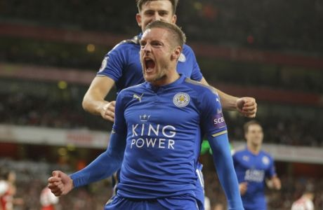 Leicester City's Jamie Vardy, centre celebrates with teammates after scoring his sides third goal of the game during their English Premier League soccer match between Arsenal and Leicester City at the Emirates stadium in London, Friday, Aug. 11, 2017. (AP Photo/Alastair Grant)