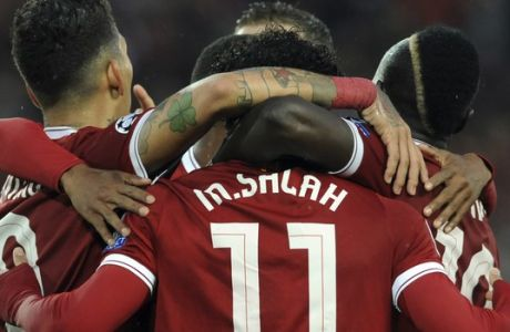 Liverpool's Mohamed Salah, center, celebrates with teammates after scoring his side's second goal during the Champions League semifinal, first leg, soccer match between Liverpool and Roma at Anfield Stadium, Liverpool, England, Tuesday, April 24, 2018. (AP Photo/Rui Vieira)
