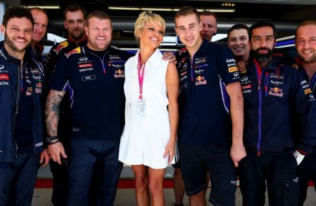AUSTIN, TX - NOVEMBER 01:  Actress Pamela Anderson poses with members of the Infiniti Red Bull Racing team outside the garage before qualifying for the United States Formula One Grand Prix at Circuit of The Americas on November 1, 2014 in Austin, United States.  (Photo by Mark Thompson/Getty Images) *** Local Caption *** Pamela Anderson
