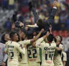 America's coach Miguel Herrera is raised by his players after defeating Cruz Azul at the final Mexico soccer league championship match at Azteca stadium in Mexico City, Sunday, Dec. 16, 2018. (AP Photo/Eduardo Verdugo)