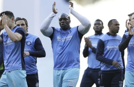 Wycombe Wanderers' Adebayo Akinfenwa, centre, and Wycombe Wanderers' Garry Thompson, right, applaud the away fans before the English FA Cup fourth round match between Tottenham Hotspur and Wycombe Wanderers at White Hart Lane in London, Saturday Jan. 28, 2017. (AP Photo/Tim Ireland)