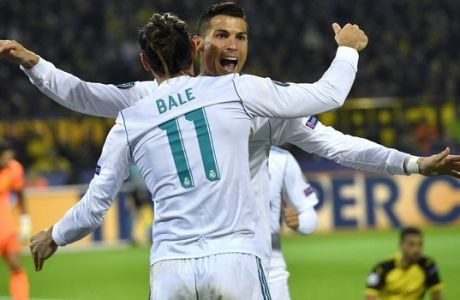 Real Madrid's scorer Cristiano Ronaldo, rear, and his teammate Gareth Bale, front, celebrate their side's 2nd goal during the Champions League group H soccer match between Borussia Dortmund and Real Madrid CF in Dortmund, Germany, Tuesday, Sept. 26, 2017. (AP Photo/Martin Meissner)