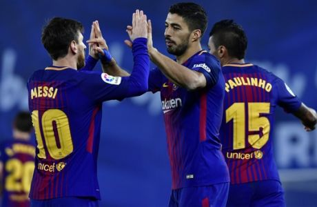 FC Barcelona's Luis Suarez, celebrates with Lionel Messi after scoring a goal during the Spanish La Liga soccer match between Barcelona and Real Sociedad, at Anoeta stadium, in San Sebastian, northern Spain, Sunday, Jan.14, 2018. (AP Photo/Alvaro Barrientos)