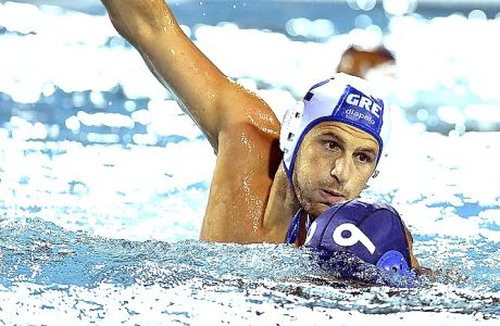 Konstantinos Genidounias, left, of Greece and Atsushi Arai of Japan in action,  during the men's water polo match for qualifying in the group of eight best teams of the 17th FINA Swimming World Championships in Hajos Alfred National Swimming Pool in Budapest, Hungary, Sunday, July 23, 2017. (Szilard Koszticsak/MTI via AP)