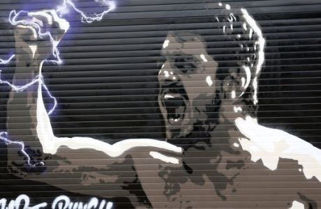 A murale depicting former AC Milan player Gennaro Gattuso is shown next to the San Siro stadium, in Milan, Italy, Monday, May 16, 2016. The Champions League final between Real Madrid and Atletico Madrid will be held at the legendary soccer stadium of AC and Inter Milan, on Saturday, May 28, 2016. (AP Photo/Luca Bruno)