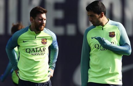 FC Barcelona's Lionel Messi, left, and Luis Suarez attend a training session at the Sports Center FC Barcelona Joan Gamper in Sant Joan Despi, Spain, Saturday, Feb. 18, 2017. FC Barcelona will play against Leganes in a Spanish La Liga on Sunday. (AP Photo/Manu Fernandez)