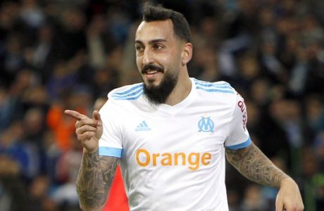 Marseille's Konstantinos Mitroglou gestures after scoring during the League One soccer match between Marseille and Caen, at the Velodrome stadium, in Marseille, southern France, Sunday, Nov. 5, 2017. (AP Photo/Claude Paris)