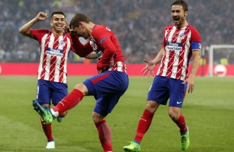 Atletico's Antoine Griezmann, center, celebrates with Angel Correa, left, and Gabi, after scoring his side opening goal during the Europa League Final soccer match between Marseille and Atletico Madrid at the Stade de Lyon in Decines, outside Lyon, France, Wednesday, May 16, 2018. (AP Photo/Thibault Camus)