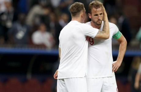 England's Harry Kane, right, and England's Eric Dier react at the end of the semifinal match between Croatia and England at the 2018 soccer World Cup in the Luzhniki Stadium in Moscow, Russia, Wednesday, July 11, 2018. (AP Photo/Rebecca Blackwell)