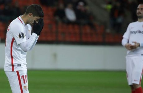 Sevilla's Ever Banega gestures, left, during the Europa League group J soccer match between Standard Liege and Sevilla at the Maurice Dufrasne stadium in Liege, Belgium, Thursday, Nov. 29, 2018. Liege won 1-0. (AP Photo/Olivier Matthys)