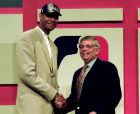 Former Wake Forest star Tim Duncan, left, shakes hands with NBA Commissioner David Stern after being selected by the San Antonio Spurs as the first pick at the NBA Draft in Charlotte Wednesday June 25, 1997. (AP Photo/