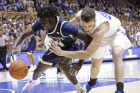 Duke's Antonio Vrankovic, right, and Georgia Tech's Abdoulaye Gueye (34) chase the ball during the first half of an NCAA college basketball game in Durham, N.C., Saturday, Jan. 26, 2019. (AP Photo/Gerry Broome)